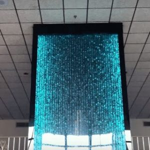 Bubble Wall Water Feature 3 Story Custom Water Wall in New Jersey with Glass Elevator