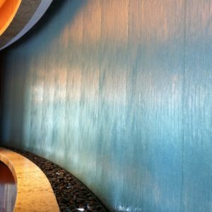 Embassy Suites Houston curved glass water wall close up scaled