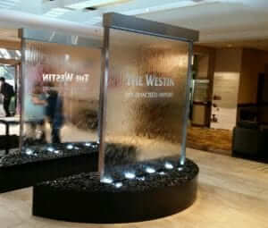 Glass and Stainless Water Wall with Half Circle Curved Basin at Westin San Franciso Airport 4 300x255