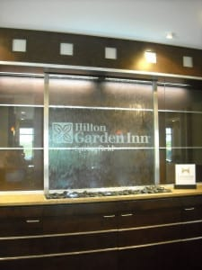 Hilton Garden Inn Springfield MO glass water wall with stainless frame water feature recessed in ceiling 2 scaled